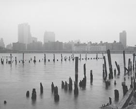 "Jed Devine<br /> <em>Rotted Pilings Between the Manhattan and Brooklyn Bridges,</em><br /> <em>from Plymouth Street, Brooklyn, 1982-3</em><br /> 2 x 6.5"", Platinum-Palladium on Japanese rice paper"