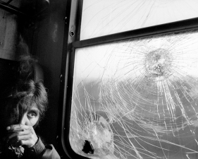 "Paolo Pellegrin<br /> <em>A Gypsy woman on the train, YUGOSLAVIA. Kosovo. 2001</em><br /> Pigment ink print<br />20 x 24""    Edition of 10 plus 2 APs<br /> 30 x 40""    Edition of 5 plus 2 APs<br /> 48 x 70""    Edition of 3 plus 2 APs"