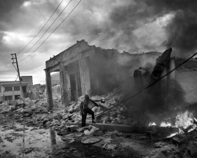"Paolo Pellegrin<br /> <em>Destruction in downtown Port au Prince. Earthquake aftermath. Haiti.</em> Jan 2010<br /> Pigment ink print<br /> 20 x 24""    Edition of 10 plus 2 APs<br /> 30 x 40""    Edition of 5 plus 2 APs<br /> 48 x 70""    Edition of 3 plus 2 APs <br />"