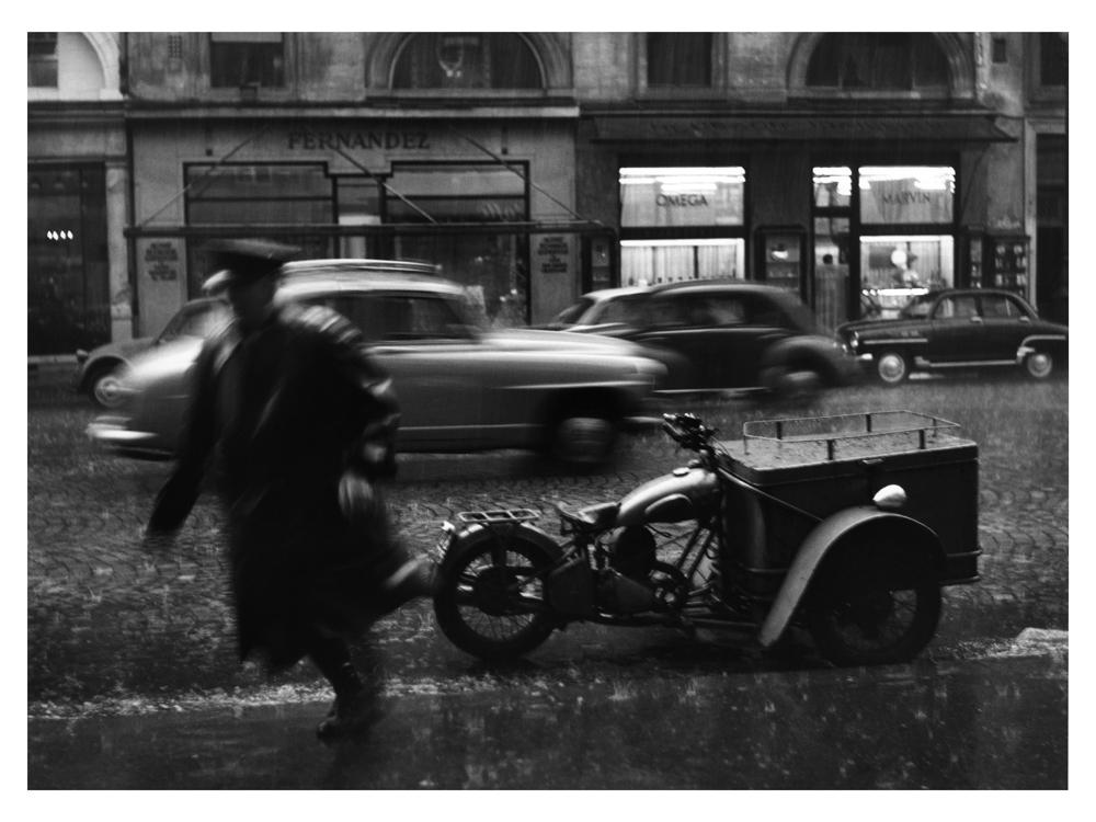 """Sabine Weiss<br /> <em>Le Triporteur, Rue de la Paix, Paris, 1957</em><br /> Silver gelatin print<br /> 12 x 16""""  Open edition<br /> 16 x 20""""  Open edition"""