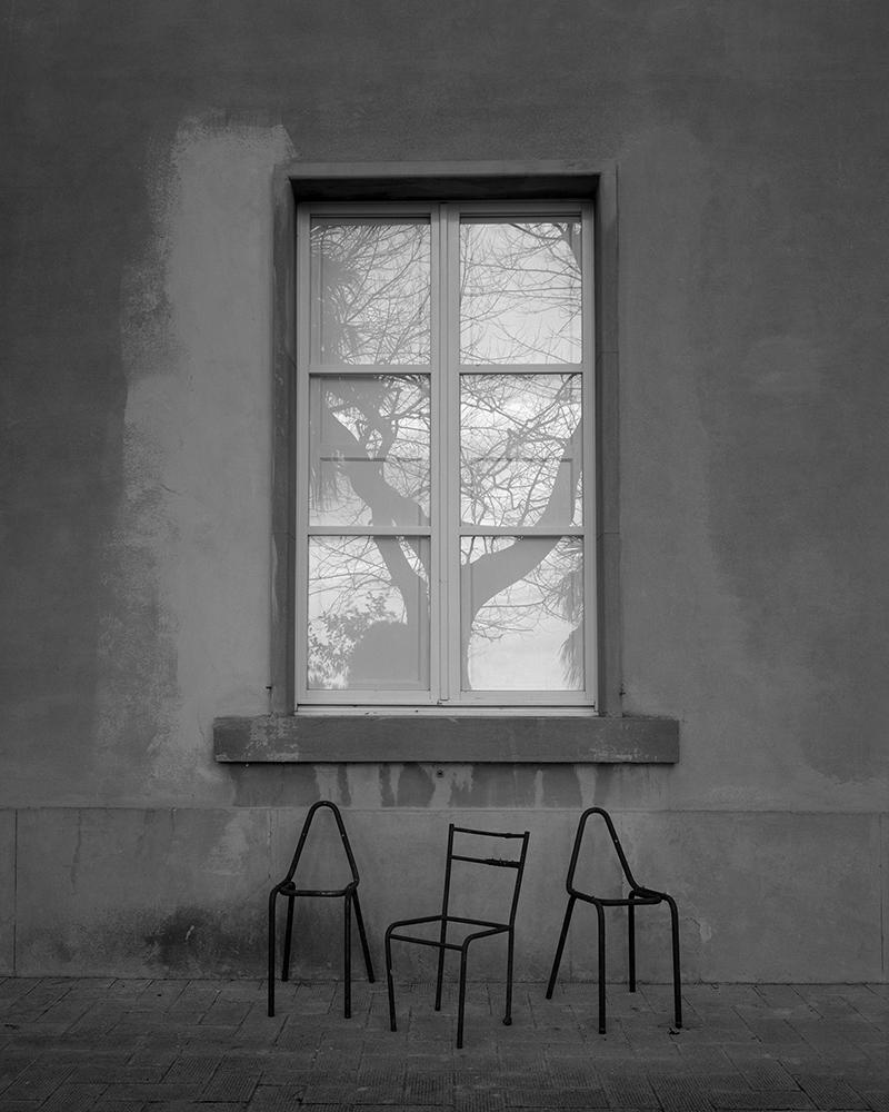 "Regina DeLuise<br /> <em>3 Chairs & Reflection, Cortona (#179)</em><br /> Platinum-palladium print on rice paper<br /> 10 x 8""  Edition of 30"