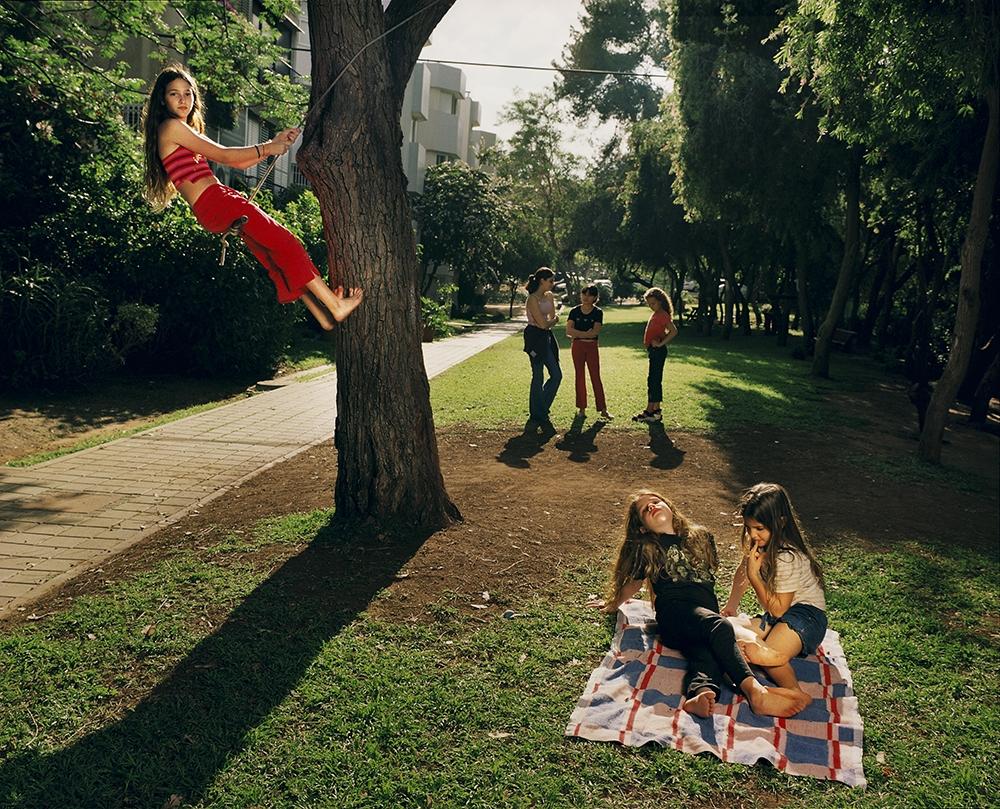 "Gillian Laub<br /> <em>Noam in her yard with some neighbors,Tel Aviv, Isreal, May, 2002</em><br /> Chromogenic prints<br /> 20 x 24""  Edition of 8<br /> 30 x 40""  Edition of 5<br /> 40 x 50""  Edition of 3"