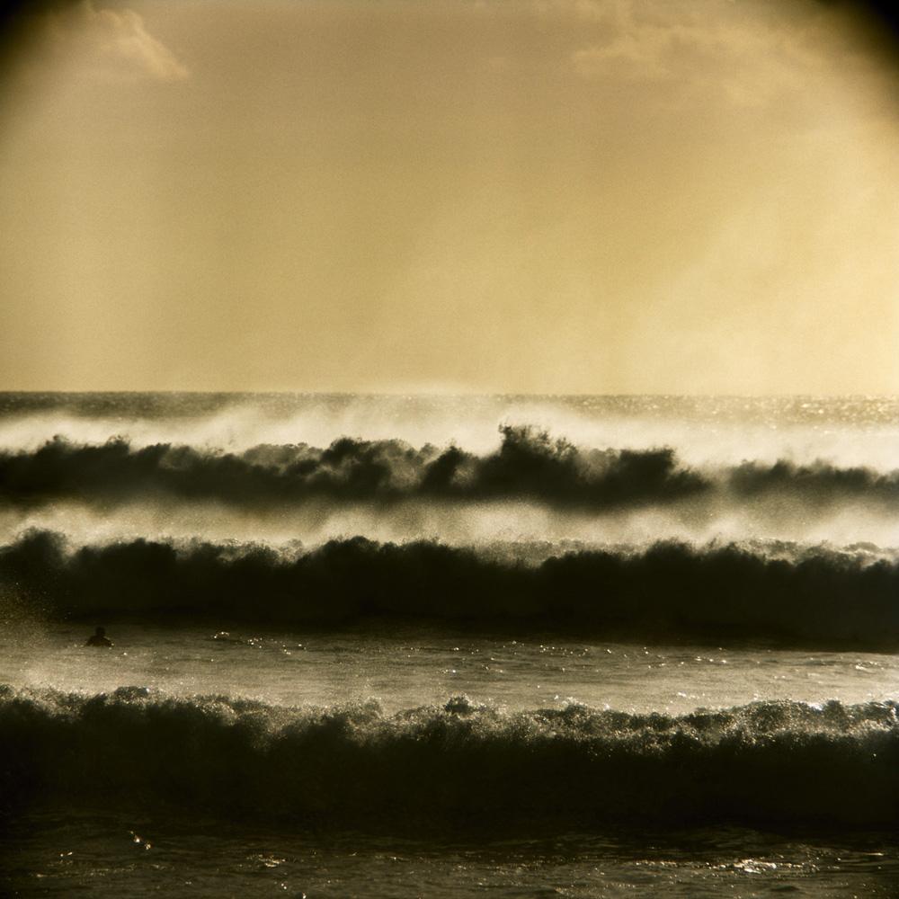 "LeRoy Grannis<br /> <em>Big Surf Storm at Ehukai Beach, </em>1969<br /> Chromogenic print<br /> 36 x 36""<br /> Edition of 18"
