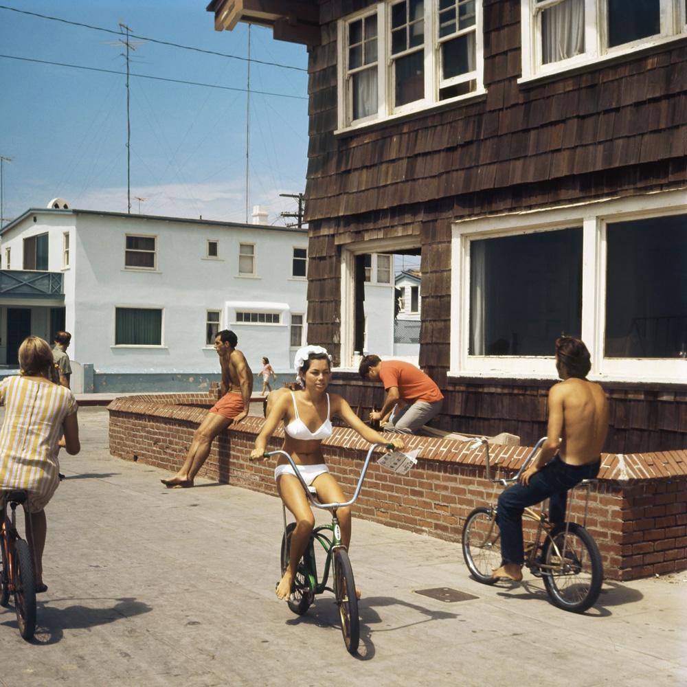 "LeRoy Grannis<br /> <em>Hermosa Beach Stand (No. 74),</em> 1967<br /> Chromogenic print<br /> 36 x 36""<br /> Edition of 18"