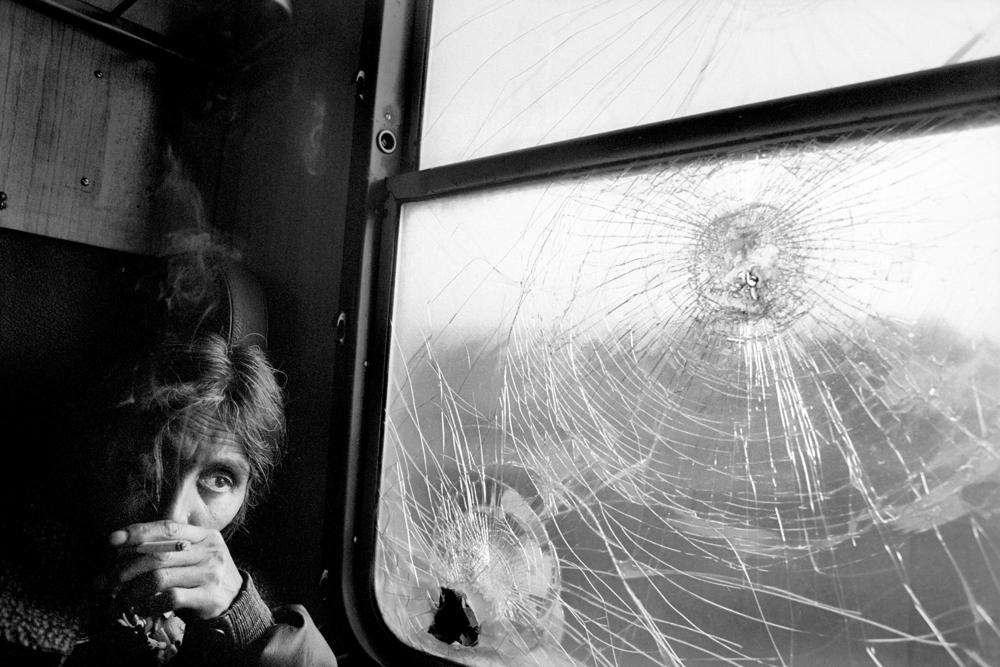 """Paolo Pellegrin<br /> <em>A Gypsy woman on the train, YUGOSLAVIA. Kosovo. 2001</em><br /> Pigment ink print<br />20 x 24""""  Edition of 10 plus 2 APs<br /> 30 x 40""""  Edition of 5 plus 2 APs<br /> 48 x 70""""  Edition of 3 plus 2 APs"""