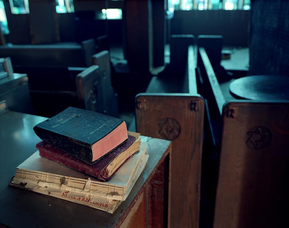 "Susannah Ray<br /> <em>Prayer Books, West End Temple, Neponsit, NY, December</em>, 2012<br /> Digital C-Prints<br /> 24 x 30""  Edition of 10<br /> 40 x 50""  Edition of 5"