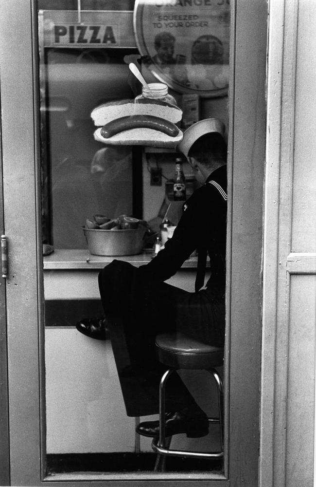 """Louis Stettner – New York<br /> <em>Sailor, Times Square, 1954</em><br /> gelatin silver print<br /> 11x14""""<br /> 16x20""""<br /> 20x24"""""""