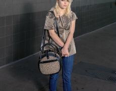 "Doug Hall<br /> <em>Girl with the Leopard-Skin Bag, San Francisco, </em>2010<br /> Archival pigment print<br /> 39 x 31""  Edition of 6"