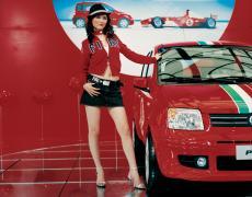 "Jacqueline Hassink<br /> <em>Fiat girl, Shanghai Auto Shanghai 2005 Shanghai, China (April 21, 2005)</em><br /> Chromogenic prints<br /> 37.5 x 31""  Edition of 7<br /> 60 x 49""  Edition of 7"