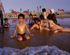 "Gillian Laub<br /> <em>Families on Jaffa Beach,Tel Aviv, Isreal, August, 2003</em><br /> Chromogenic prints<br /> 20 x 24""  Edition of 8<br /> 30 x 40""  Edition of 5<br /> 40 x 50""  Edition of 3"