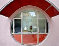 "Jeffrey Milstein<br /> <em>Movie Ticket Booth, Camaguey, Cuba, </em>2004<br /> Archival pigment prints<br /> 16 x 24""  Edition of 15<br /> 22 x 33""  Edition of 5"