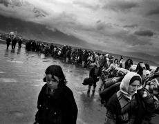 "Paolo Pellegrin<br /> <em>Fleeing Kosovar refugees arrive in Kukes, Albania. 1999</em><br /> Pigment ink print<br />20 x 24""  Edition of 10 plus 2 APs<br /> 30 x 40""  Edition of 5 plus 2 APs<br /> 48 x 70""  Edition of 3 plus 2 APs"