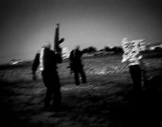 """Paolo Pellegrin<br /> <em>Al Aqsa Martyr Brigades militants secretly training near Gaza, Palestine, Gaza</em>, 2002<br /> Pigment ink print<br /> 20 x 24""""  Edition of 10 plus 2 APs<br /> 30 x 40""""  Edition of 5 plus 2 APs<br /> 48 x 70""""  Edition of 3 plus 2 APs<br />"""