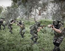 "Paolo Pellegrin<br /> <em>Islamic Jihad militans train in a location around Gaza city. Gaza 2011</em><br /> Pigment ink print<br />20 x 24""  Edition of 10 plus 2 APs<br /> 30 x 40""  Edition of 5 plus 2 APs<br /> 48 x 70""  Edition of 3 plus 2 APs"